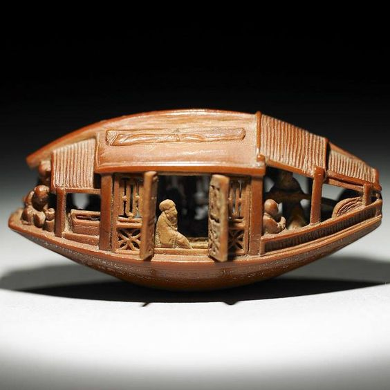 A mere 3.4 cm (1.34 inches) in length and 1.6 cm (0.63 inches) tall, this carved olive pit from 1737 is one of the most intricate artworks you will see. The perfectly preserved Carved Olive-Stone Boat was crafted by artist Ch'en Tsu-chang during China's Ch'ing dynasty.