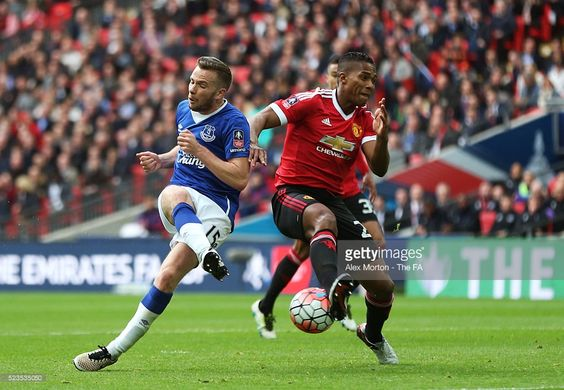 Tom Cleverley of Everton is closed down by Antonio Valencia of Manchester United during the Emirates FA Cup Semi Final match between Everton and Manchester United at Wembley Stadium on April 23, 2016 in London, England.