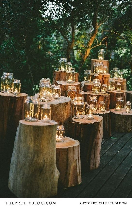 Event decor idea: Tree stumps with candelight for an outdoor wedding | Mosaic Private Sanctuary| Photograph by Claire Thomson |: