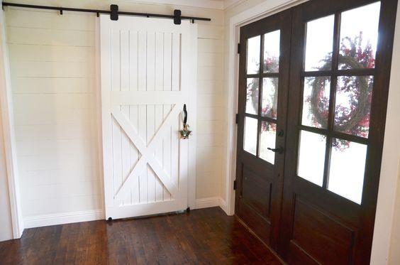 How to hang a barn door flats pantry and barn doors for Hanging barn door in house