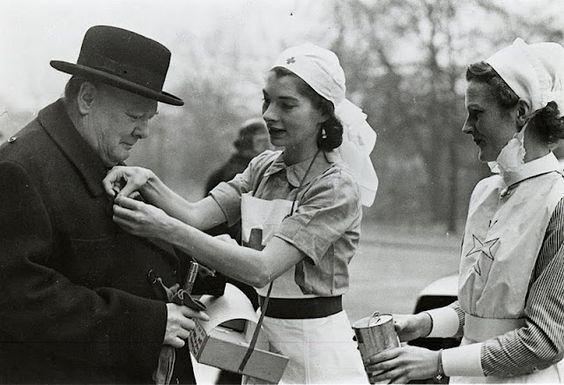 Winston Churchill with nurses on a JWO flag day