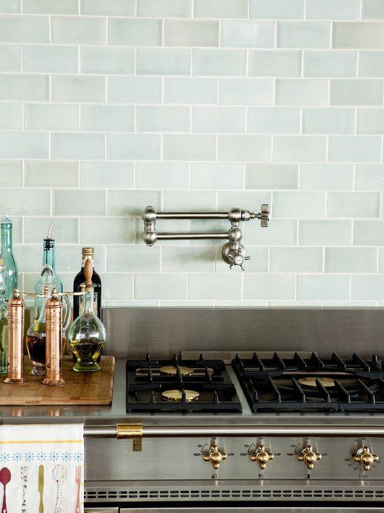 Light Green Subway Tile Back Splash With Light Brown Quartz Counter Tops Light Cabinets But Darker Base Blue Backsplash Kitchen Remodel Kitchen Inspirations