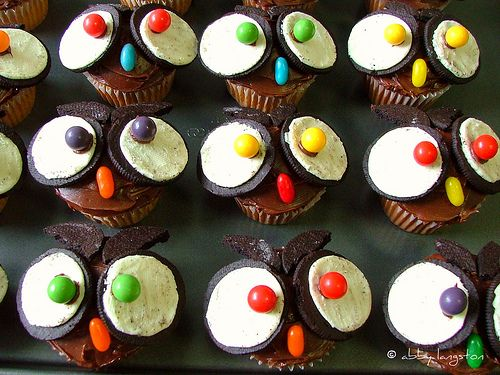 Owl cupcakes for Sam's school party this Friday!  Going to use candy corn for the noses.