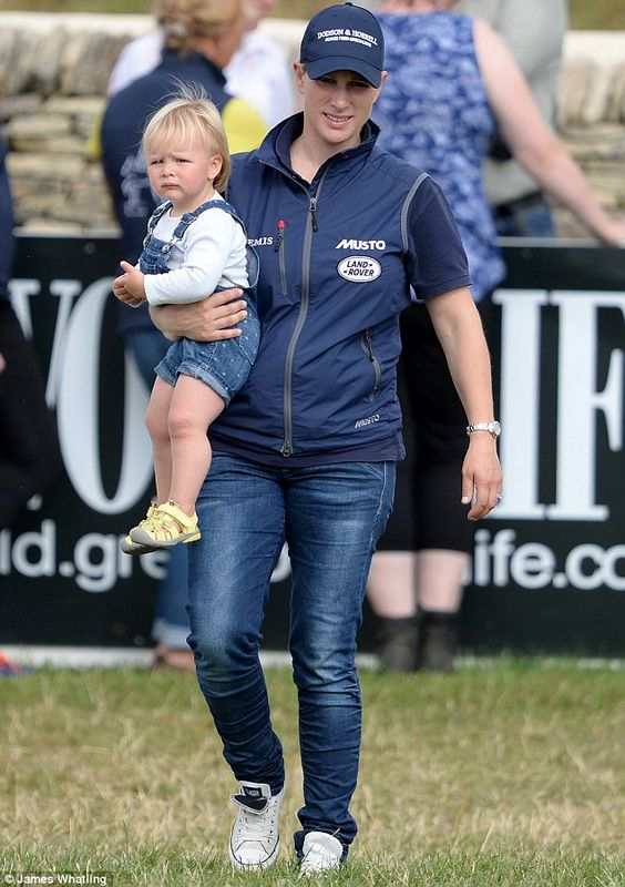 On the go: The mother-of-one was laid back in some blue jeans, trainers and a body warmer ...