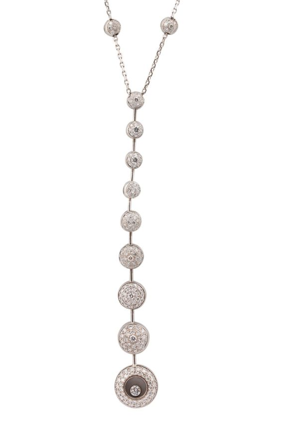 """Chopard 18K White Gold Diamond """"Happy Diamond"""" Necklace - Chopard 18K White Gold Diamond """"Happy Diamond"""" Necklace. This """"Y"""" necklace features approximately 131 diamonds for a total carat weight of 1.12 carats. The necklace chain measure 15 inches in length. Part of Chopards most iconic """"Happy Diamonds"""" collection, this stand out piece is a stunning addition to any jewelry collection and is in excellent condition."""