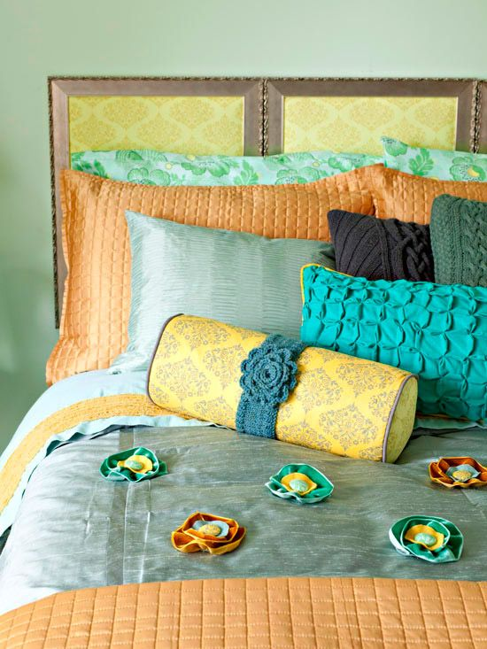 Headboard made of old frames and fabric.  interesting.  shops and make a magnificent headboard. Remove the glass from the frames and cut batting the same size as the frame back. Cut fabric to size, adding 3 inches on each side. Lay the batting on the frame back and cover it with the fabric, wrapping excess over the back. Pull taut and fasten with duct tape. Insert the back into the frame. Hang three frames side by side for a picture-perfect headboard