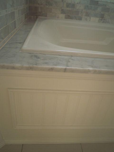 Decks tub surround and tile wood on pinterest for Wood tile tub surround