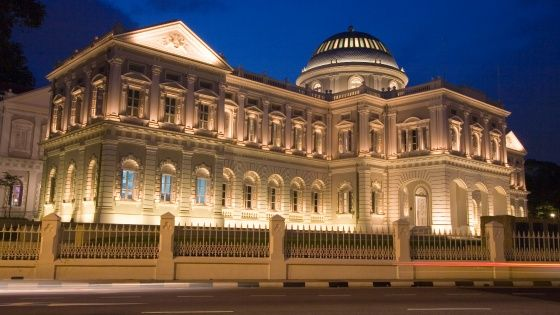 National Museum of Singapore façade in the evening being lighted up