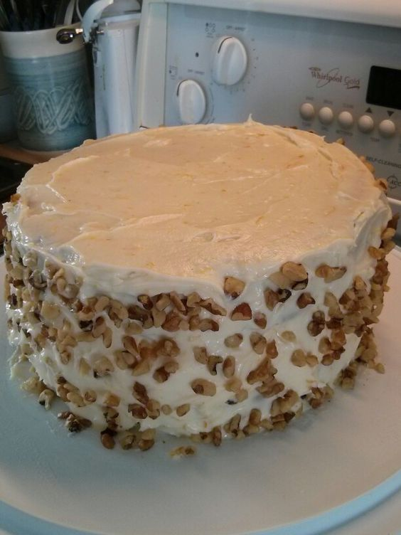 Two-tiered spiced carrot cake with orange cream cheese frosting: