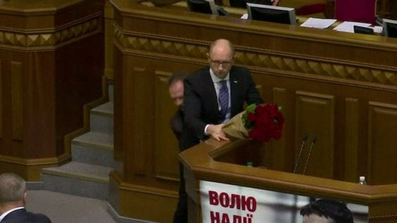 11 DEC: Ukrainian Prime Minister Arseny Yatseniuk was addressing the parliament in Kiev when one of the lawmakers approached him with a bouquet of roses and pulled him from the podium. Physically. A brawl between members of parliament followed. #BBCShorts @BBCNews #Rada #Kiev  #Ukraine #Yatseniuk by bbcnews