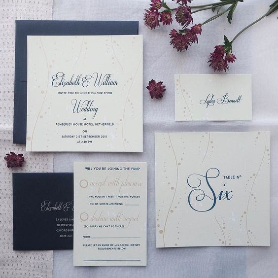 Nerine wedding stationery in pretty pale green us partly inspired by Klimt's water serpents series.