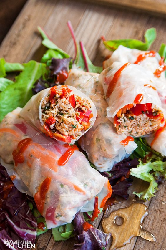 Honey Sriracha Chicken Spring Rolls - this slow cooker dinner recipe uses rice paper wrappers and is not only gluten free but paleo and 21 day fix approved as well. | TheBewitchinKitchen.com: