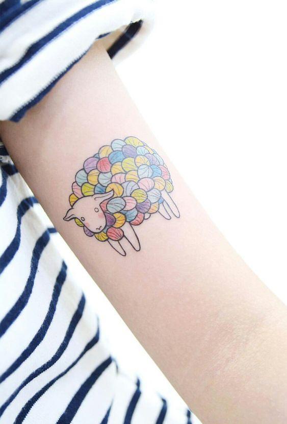 Colourful sheep tattoo