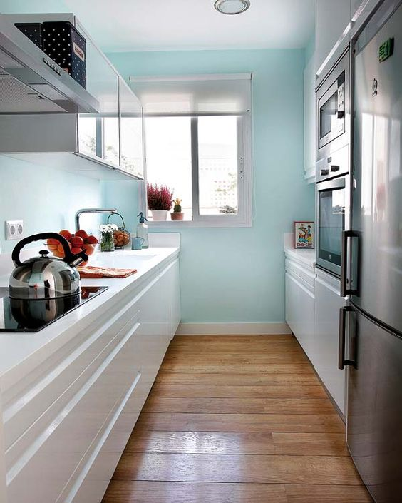 What a bright, beautiful galley kitchen.  A galley doesn't have to be cramped, and can be very efficient for cooking.