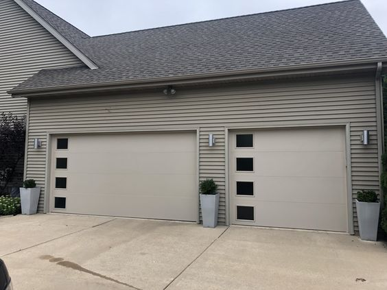 Modern Steel Collection With Small Square Windows Vertically Placed Down One Side Are The Finishin Garage Door Repair Service Square Windows Garage Door Repair