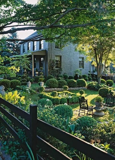 .I love the yard and the home beyond it makes me curious to see the inside of it!