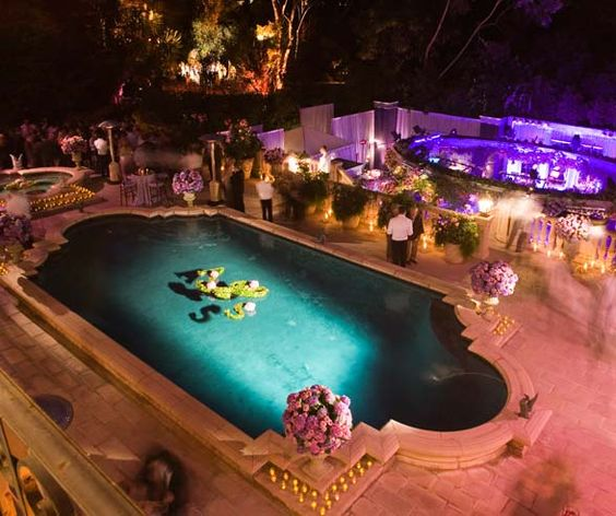 Lighting around the pool highlighted the floating floral monogram.