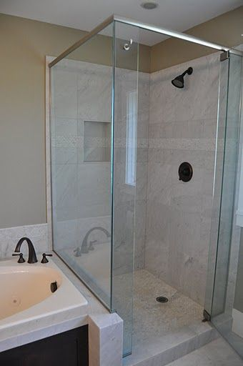 Google Image Result for http://jimscustomtileandcabinetry.com/gallery/var/albums/Showcase/Tile-Showers-and-Pans/Carerra%2520Marble%2520Shower%2520surround.JPG%3Fm%3D1314844575