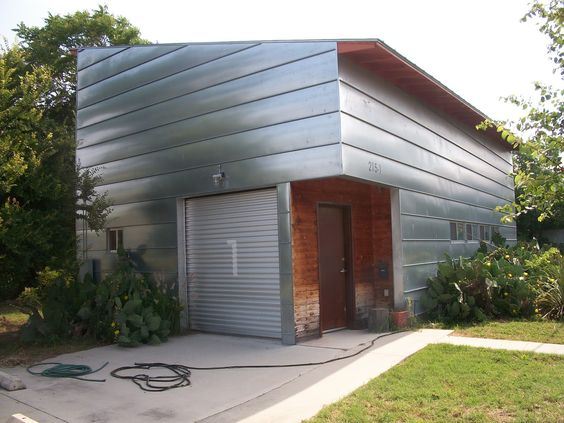 Metal siding for exterior of house this modern home with for Modern house siding
