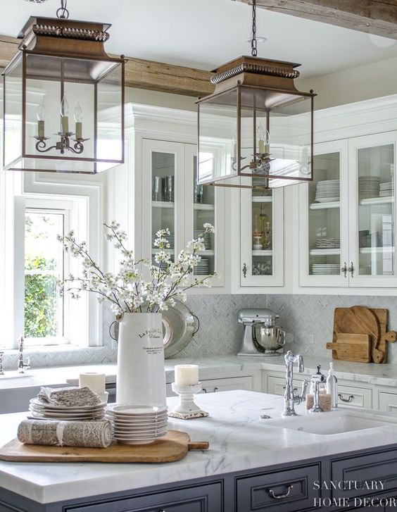Kitchen LOOKS ABSOLUTELY FABULOUS, THE GORGEOUS DOWNLIGHTS, THE GLASS FRONTED CABINETS, THE LARGE BENCH & TOTALLY STUNNING PIECES, USED AS DECOR!