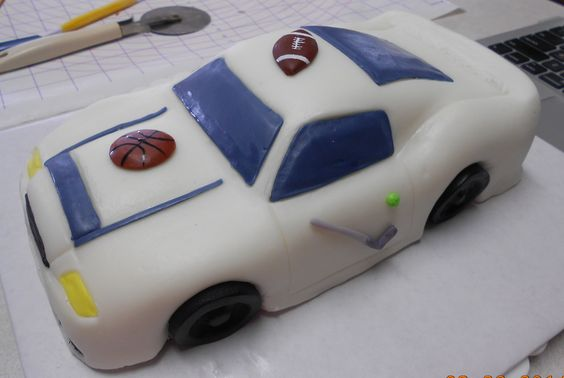 This is a sports car cake. Baked the cake in a bread pan, sculpted it into a car, covered in fondant.