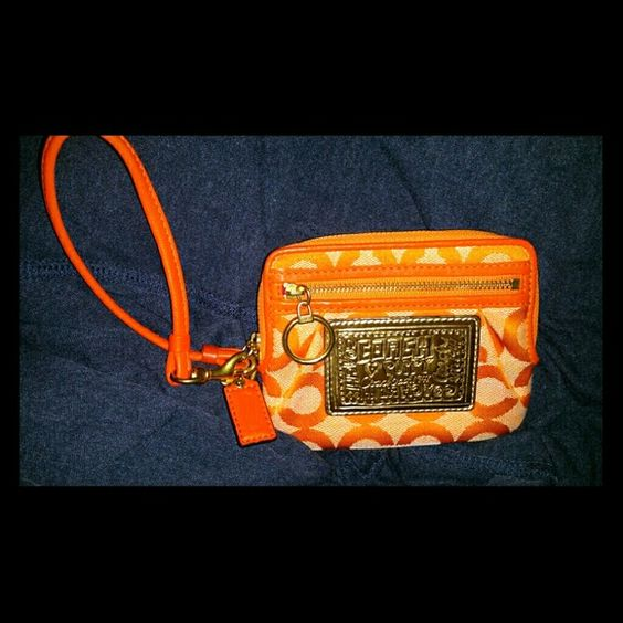 Orange poopy coach clutch Orange and punk coach poppy clutch. In great condition, very clean with hang tag. Coach Bags Clutches & Wristlets