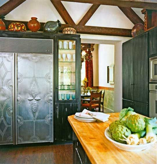 Maybe a neat way to incorporate the fridge into an early american style house/kitchen.  Make it look like a pie safe?