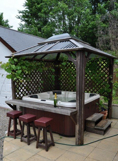 This wood gazebo is a little more rustic but it's definitely something unique because you get a bar, elegant style legs and a trellis on the back to grow your favorite vines as well.
