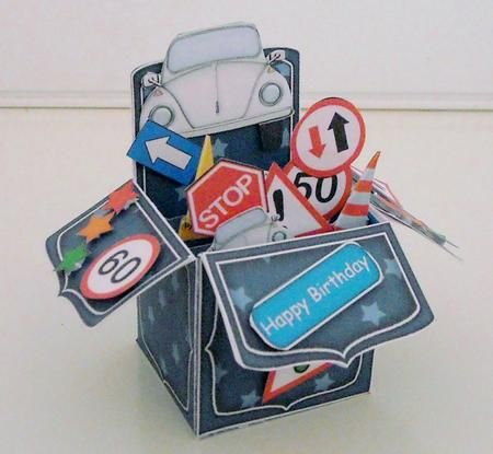 3D VW Beetle Car Rubber Band Pop Up Box Card on Craftsuprint designed by Carol Clarke - made by Pam Stubley - I printed this kit, including the backing paper onto 160gsm card at half size and cut out all the pieces. I scored and folded as required and added backing sheet, using a wet glue, to strengthen the base as well as to hide any white areas. I assembled the card and added a rubber band and then all the embellishments by using either foam pads or dst. These are brilliantly novel ways of…