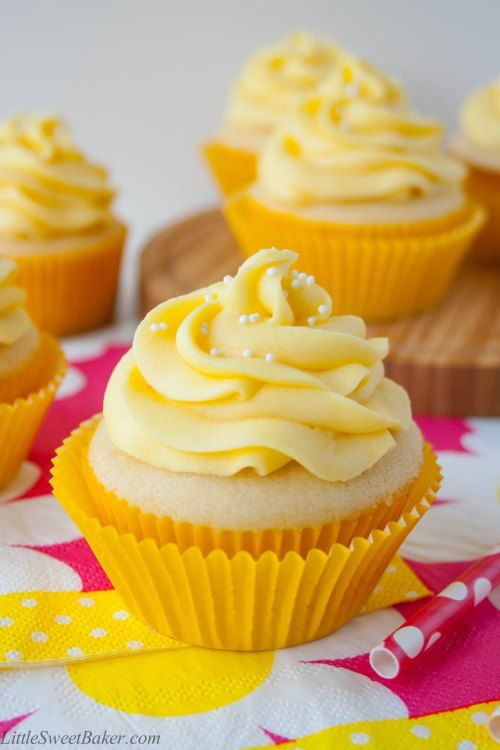 TROPICAL MANGO VANILLA CUPCAKES. Rich buttery vanilla cupcake with a hint of coconut and a fresh mango buttercream.