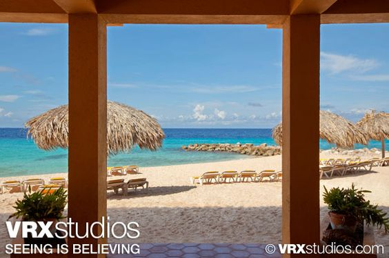 A striking view of Parasasa Beach and the turquoise blue water of the Caribbean Sea from #Hilton #Curacao. View more hotel and resort photography here: http://www.vrxstudios.com