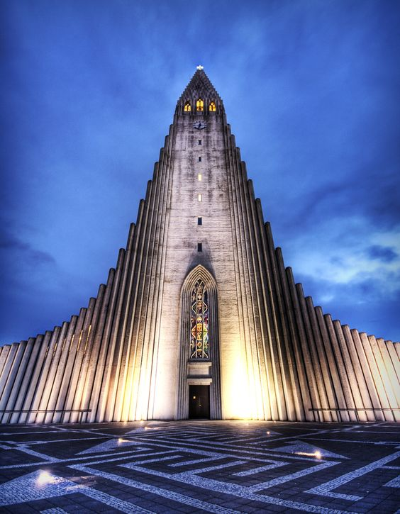 The Hallgrimskirkja in Reykjavik has a really impressive design which is inspired by large basalt formations in other parts of the country. There's a stairs to the top with a nice view.