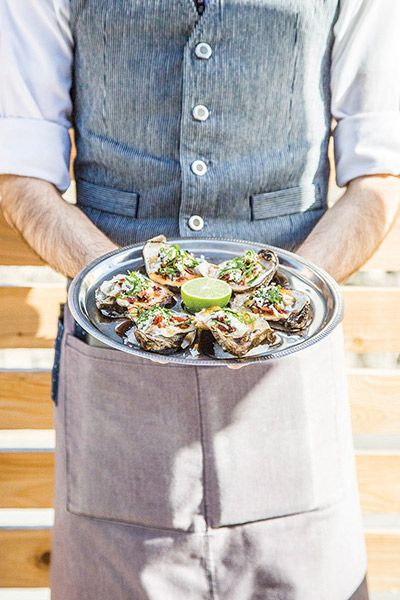 New restaurant Fork & Vine is already making its mark on Anderson Lane with dishes like these broiled oysters.