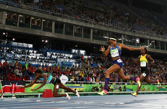 Shaunae Miller of the Bahamas (L) dives over the finish line to win the gold medal in the Women's 400m Final ahead of silver medalist Allyson Felix of the United States (C) and bronze medalist Shericka Jackson of Jamaica (R) on Day 10 of the Rio 2016 Olympic Games at the Olympic Stadium on August 15, 2016 in Rio de Janeiro, Brazil. (Aug. 14, 2016 - Source: Alexander Hassenstein/Getty Images South America)