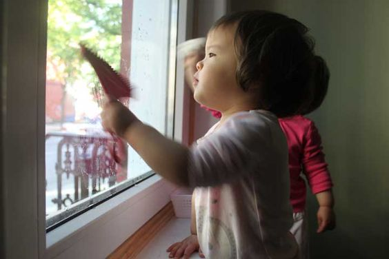 Window cleaning is a great Montessori Practical Life activity perfect for the home. Here's how we do it--  Here is Mackenzie with her spray bottle - just water inside. What I like about this bottle is, though the part you squeeze is wide for little hands, it is quite loose, so they were able to get water out of the bottle early on by using both hands. We have another spray bottle that is smaller and tighter and took much longer for them to master.  She can finally 'one-hand' it!  She uses a…