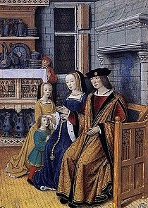 Anne de Bretagne et Louis XII sont assis devant une cheminée. A leur droite : Claude (de taille anormalement grande : née le 13 octobre 1499, elle n'a pas encore 3 ans et demi en 1503) et François représenté sous les traits d'un enfant de 3 à 5 ans environ !     Miniature de Jean Bourdichon ? École Nationale Supérieure des Beaux-Arts, Paris--reine roi et dauphin