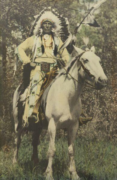 stoney nakoda indian chief on horse back native