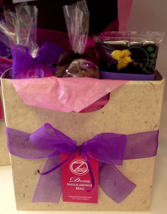 "Our Divine Indulgence Bag is all ""Packaged Up"" ready for you it ""Pick Up"". ""The Blossom Bar,"" a 15 piece Spring boxed assortment with flavors that include cherry blossom, apple blossom and fresh mint, a bag of our chocolate-covered, cocoa-dusted almonds and a pair of designer chocolate shoes. For ordering information please visit our website at www.zoeschocolate.com or stop in at either location in Frederick or in Waynesboro."