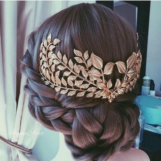 brunette braided hair updo gold leaves fascinator