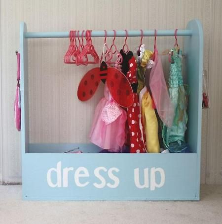 """Cutest Dress up closed DIY. Now the dress up costumes can have its own dedicated """"closet"""" and at the same time it decorates the little ones space. Or make a smaller one to hang up and store doll clothes."""