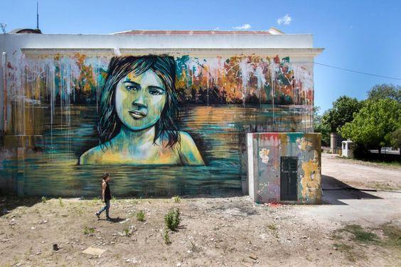 """""""Italiani in trasferta. I murales di Alice Pasquini in Sud America, per l'IIC di Montevideo. Fiumi, scorci urbani, volti infantili e accenti surreali..."""