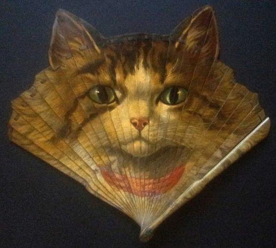 """An antique folding """"cat"""" fan by the fan maker Duvelleroy.:"""