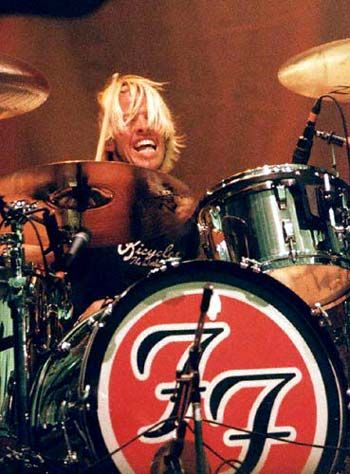 The man who inspired me to begin playing drums... Taylor Hawkins on drums with red black ff symbol on drums