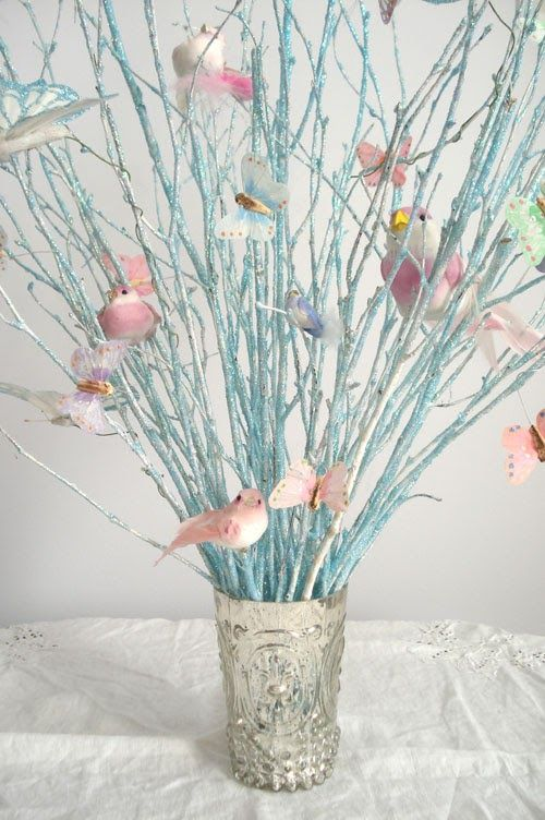 These glittery branches with birds and butterflies add a touch of contrast to any room.