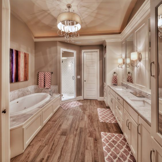 Master bathroom  hardwood floors  large tub  his and her sink. Master bathroom  hardwood floors  large tub  his and her sink