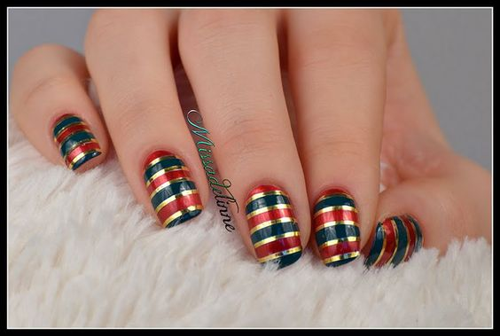 Christmas Stripes Manicure - Gift wrap your nails in this festive gold and red manicure! Discover which products to use to get this elegant look: http://www.preen.me/look/1341017