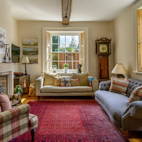 Neutral country living room with large red rug | work refs ...