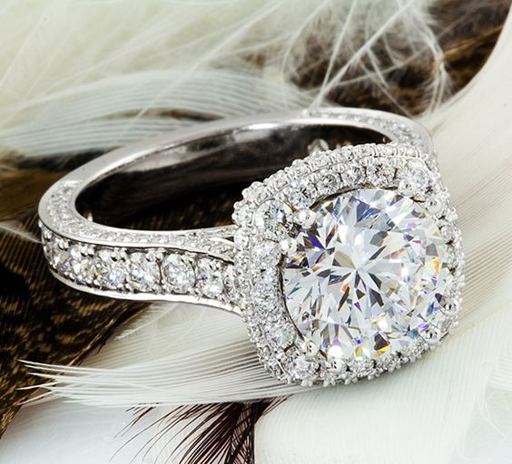 Engagement Halo ring. 3.0ct round Diamond center stone. Cushion setting! Diamonds in every corner and side. Custom made by Treasures Jewelry