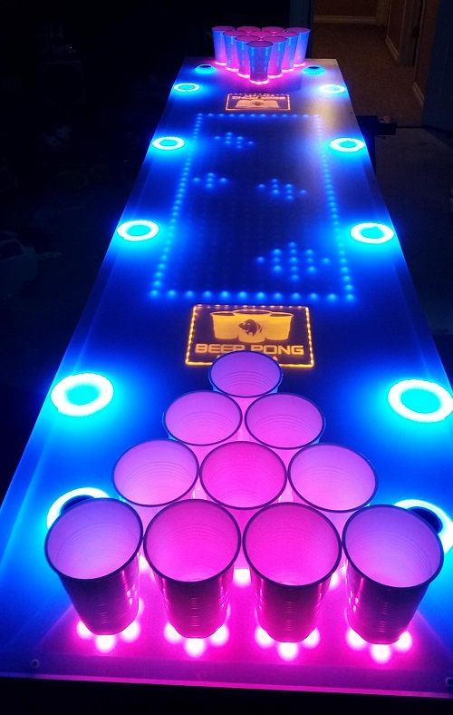 Interactive glow-in-the-dark beer pong table