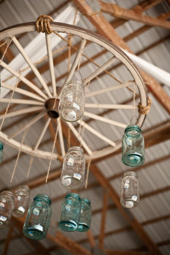 Wagon wheel & mason jar chandelier!